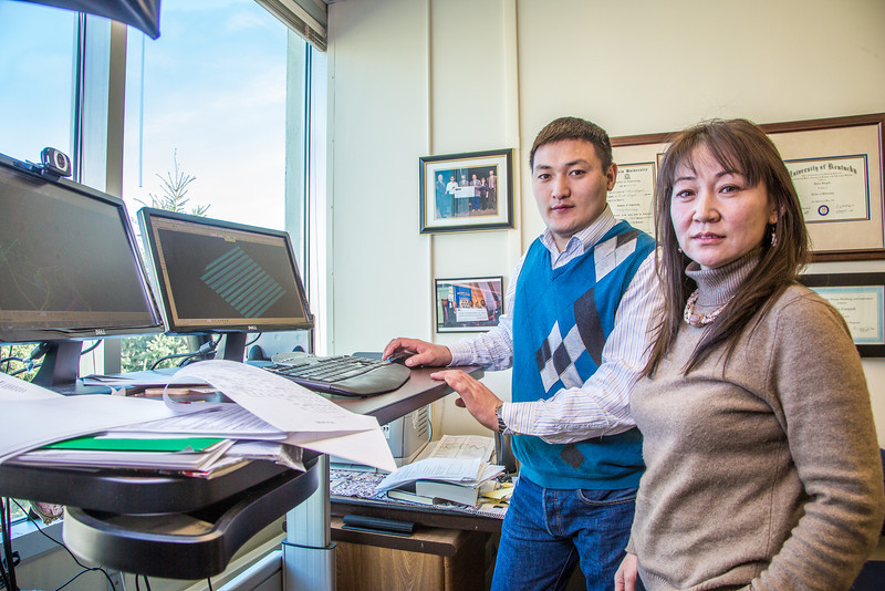 "Term Prof. Ariunbolor Purvee, right, works with mineral engineering graduate student Erdenebaatar Dondov to study software models of mining design in his Duckering Building office. Purvee is helping Dondov and the government in his home country of Mongolia to establish a school of mining engineering there to educate locals to help develop the country's mineral resources.  <div class=""ss-paypal-button"">Filename: AAR-13-3842-21.jpg</div><div class=""ss-paypal-button-end"" style=""""></div>"