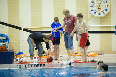 Middle school students try out their recently built remotely operated vehicles inside the Hamme Pool as part of the Alaska Summer Research Academy.  Filename: AAR-13-3861-66.jpg