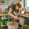 "Art major Ian Wilkinson mixes glaze in the UAF ceramics studio.  <div class=""ss-paypal-button"">Filename: AAR-13-3752-5.jpg</div><div class=""ss-paypal-button-end"" style=""""></div>"