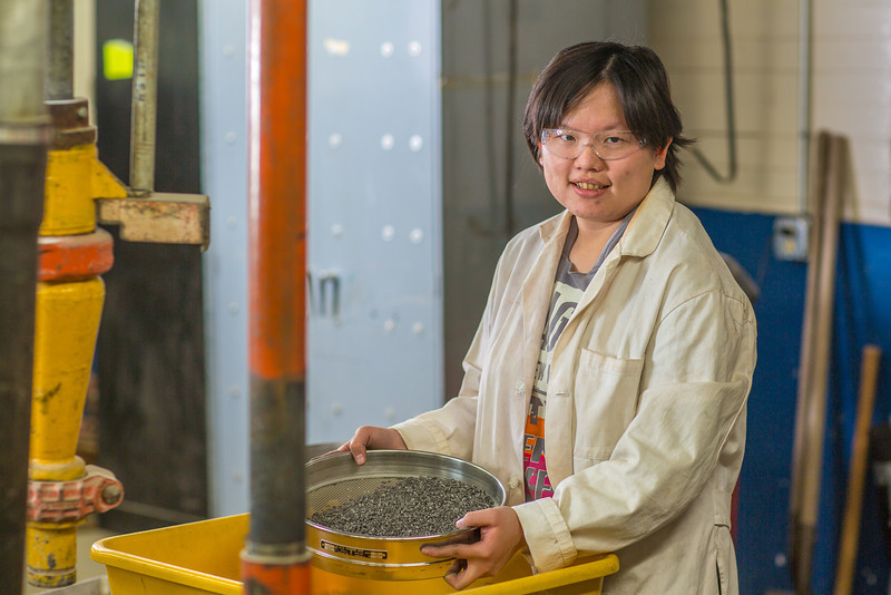 "Hsin-Hui Yen filters crushed ore through a sieve as part of her research at the Mineral Industry Research Lab (MIRL) facility in the barn at the UAF Agricultural and Forestry Experiment Station.  <div class=""ss-paypal-button"">Filename: AAR-12-3549-139.jpg</div><div class=""ss-paypal-button-end"" style=""""></div>"