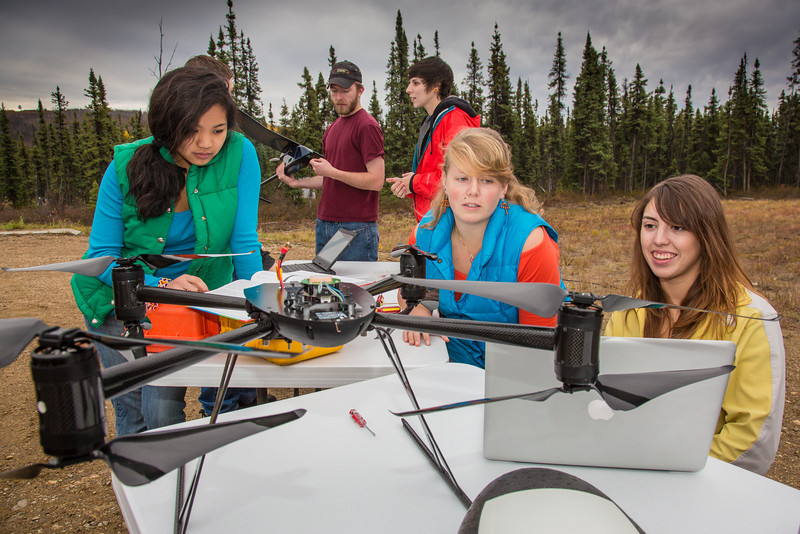 """Students take part in a project using unmaned aerial vehicles (UAVs) at Poker Flat Research Range about 40 miles northeast of the Fairbanks campus. (Note: Taken as part of commercial shoot with Nerland Agency. Pretend class -- use with discretion!)  <div class=""""ss-paypal-button"""">Filename: AAR-12-3560-046.jpg</div><div class=""""ss-paypal-button-end"""" style=""""""""></div>"""