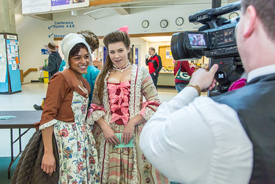 "Nicole Cowans, left, and Katrina Kuharich, cast members in Theatre UAF's production of ""Tartuffe"" are interviewed by local media  after performing a live teaser in Wood Center a couple of days before opening night.  Filename: AAR-14-4121-62.jpg"