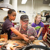 "Eli Evans, 11, reaches for a tool at metals class during UAF's Visual Arts Academy.  <div class=""ss-paypal-button"">Filename: AAR-12-3427-24.jpg</div><div class=""ss-paypal-button-end"" style=""""></div>"