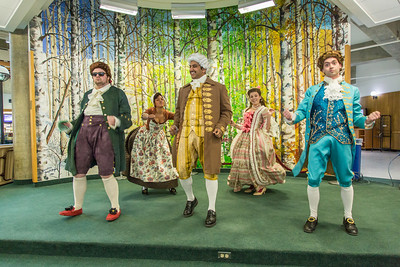 """Cast members of Theatre UAF's production of """"Tartuffe"""" perform an original dance as part of a live teaser in Wood Center a couple of days before opening night.  Filename: AAR-14-4121-52.jpg"""
