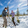 "Daisy Huang, right, a research engineer for the Alaska Center for Energy and Power, works with ACEP intern Luke George to install a meteorological station on a hillside near the Black Rapids Lodge, about 150 miles southeast of Fairbanks. The station will record wind speed and direction, as well as temperatures at different altitudes.  <div class=""ss-paypal-button"">Filename: AAR-13-3843-79.jpg</div><div class=""ss-paypal-button-end"" style=""""></div>"