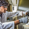"Graduate student Mukul Chavan pours a sample of heavy crude oil from the Kaparuk field on Alaska's North Slope. Chavan and other students in UAF's petroleum engineering program are using the samples to experiment with ways to recover more oil from existing fields.  <div class=""ss-paypal-button"">Filename: AAR-13-3918-132.jpg</div><div class=""ss-paypal-button-end"" style=""""></div>"