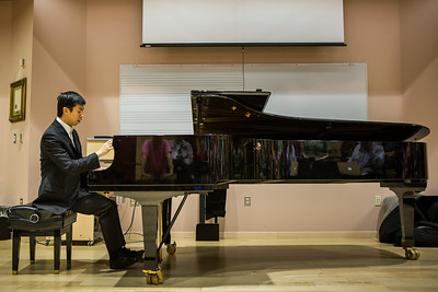 Contestant Martin Leung, also known as the video game pianist, performs music from video games at a public lecture during the Alaska International Piano-e-Competition  Filename: AAR-14-4234-11.jpg