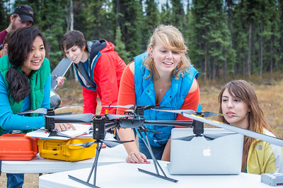 Students take part in a project using unmaned aerial vehicles (UAVs) at Poker Flat Research Range about 40 miles northeast of the Fairbanks campus. (Note: Taken as part of commercial shoot with Nerland Agency. Pretend class -- use with discretion!)  Filename: AAR-12-3560-088.jpg