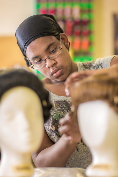 "Sophomore theater major Erlee Hjellen works at ""wig master"" for Theatre UAF's production of Tartuffe.  <div class=""ss-paypal-button"">Filename: AAR-14-4104-155.jpg</div><div class=""ss-paypal-button-end"" style=""""></div>"