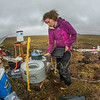 "Ludda Ludwig, a Ph.D. candidate with UAF's College of Natural Science and Mathematics, transfers data from a climate recording station at a research site near the headwaters of the Kuparuk River on Alaska's North Slope. Ludwig's research involves the movement of water and nutrients from Arctic hillslopes to streams.  <div class=""ss-paypal-button"">Filename: AAR-14-4217-079.jpg</div><div class=""ss-paypal-button-end""></div>"