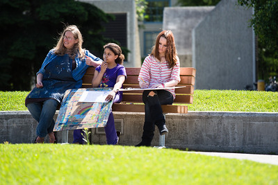 Visual Arts Academy cartooning class draws outside on Constitution Park on a sunny day.  Filename: AAR-12-3430-19.jpg