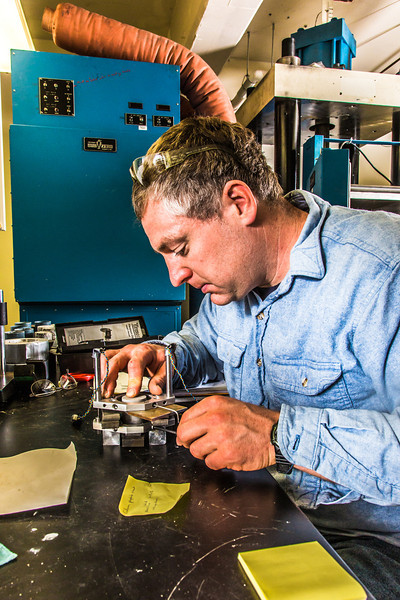 """Research professional Matt Bray prepares concrete samples for testing under extreme pressure in a Duckering Building rock mechanics lab.  <div class=""""ss-paypal-button"""">Filename: AAR-13-3919-64.jpg</div><div class=""""ss-paypal-button-end"""" style=""""""""></div>"""