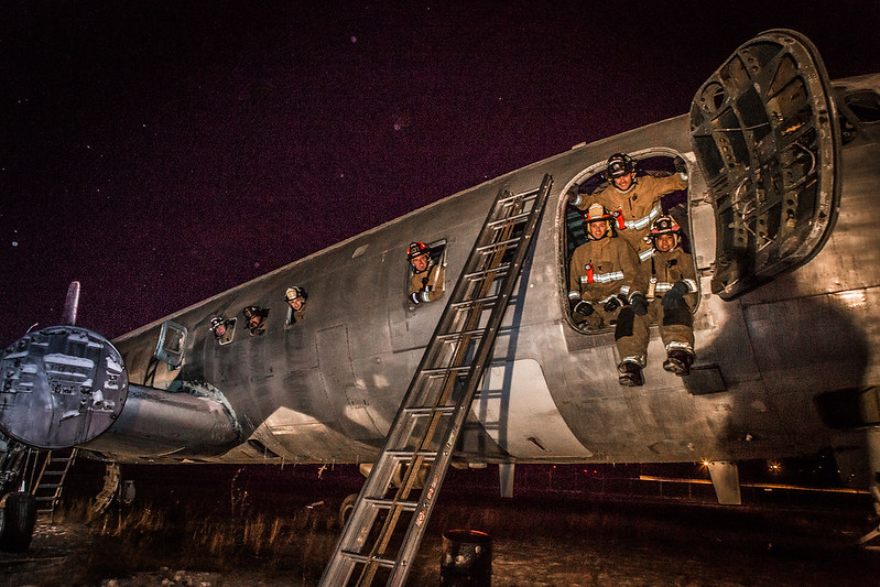 "Firefighters with the University Fire Department pose in an abandoned cargo plane after completing a live training drill at the Fairbanks International Airport.  <div class=""ss-paypal-button"">Filename: AAR-13-3995-239.jpg</div><div class=""ss-paypal-button-end"" style=""""></div>"