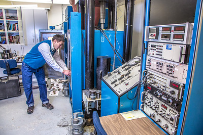 UAF graduate student Erdenebaatar Dondov works with samples of rare earth minerals in a Duckering Building lab. Narantsetseg is part of a partnership between UAF and the Mongolian government to establish a school of mining engineering there to educate locals to help develop the country's mineral resources.  Filename: AAR-13-3842-95.jpg