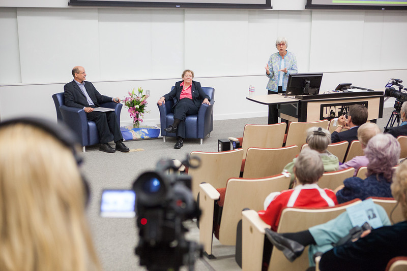 """Summer Sessions Director, Michelle Bartlett welcomes the audience and introduces host Robert Hannon with Legacy Lecturer Vera Alexander at the Murie Building Auditorium.  <div class=""""ss-paypal-button"""">Filename: AAR-13-3852-18.jpg</div><div class=""""ss-paypal-button-end"""" style=""""""""></div>"""