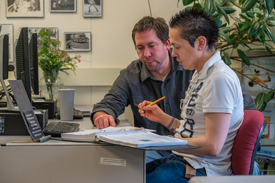 Faculty member Zach Fansler, left, helps local student Gerald Anvil with a math assignment at at UAF's Kuskokwim Campus in Bethel.  Filename: AAR-16-4859-080.jpg