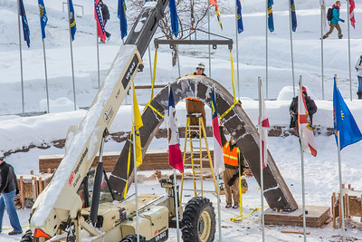 Engineering students and volunteers from GHEMM Company raise the 2013 ice arch in Cornerstone Plaza on the Fairbanks campus. Students this year built the structure out of a mixture of ice and sawdust, which is many times stronger than concrete.  Filename: AAR-13-3736-67.jpg