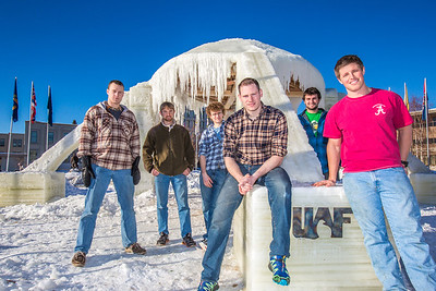 """Engineering students pose by the 2014 ice arch they designed and built on the Fairbanks campus -- a tradition dating back to the 1950s. From left to right are Daniel Hjortstorp,  Tux Seims, Vincent Valenti, Andy Chamberlain, Richard """"Buzz"""" Ward and James """"Tripp"""" Collier.  Filename: AAR-14-4093-11.jpg"""