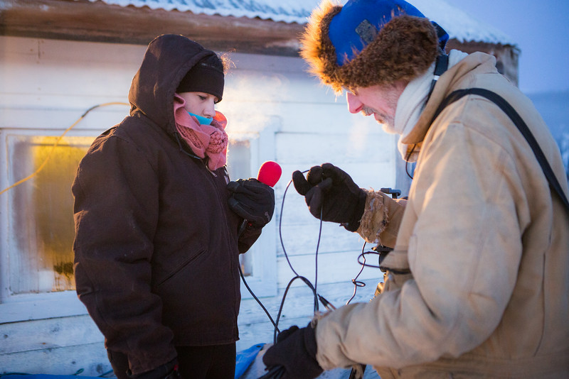 "Monica Combs and journalism professor Brian  O'Donoghue prepare to interview mushers from the 2014 Yukon Quest at the Mile 101 checkpoint.  <div class=""ss-paypal-button"">Filename: AAR-14-4060-3.jpg</div><div class=""ss-paypal-button-end""></div>"
