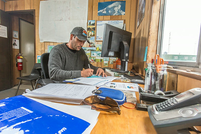 Research technician Jorge Noguera supports research efforts at IAB's Toolik Field Station in the GPS unit.  Filename: AAR-14-4216-042.jpg