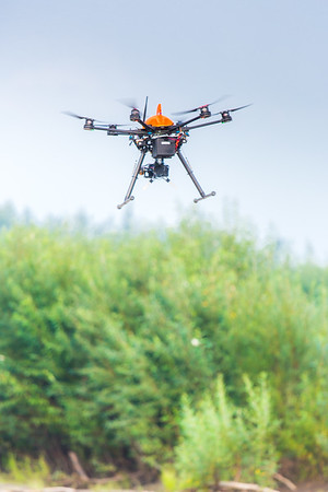 An unmanned aerial vehicle (UAV) stands ready to collect video of important king salmon spawning habitat along a popular stretch of the upper Chena River about 40 miles northeast of Fairbanks. The project was a collaboration between the Alaska Center for Unmanned Aircraft Systems Integration (ACUASI) and the U.S. Fish and Wildlife Service.  Filename: AAR-15-4593-337.jpg