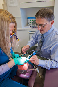 Program director Vaughan Hoefler works with one of his students in CTC's dental hygienist program in their training facility in downtown Fairbanks.  Filename: AAR-12-3308-051.jpg