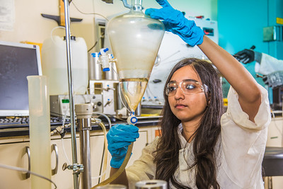 Graduate student Shruti Oza sets up apparatus for a procedure in UAF's Petroleum Development Lab in the Duckering Building.  Filename: AAR-13-3918-218.jpg