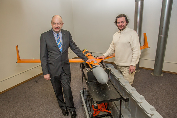 """Marty Rogers, left, chief operating officer with the Alaska Center for Unmanned Aircraft Systems Integration (ACUASI), stands with Sigurder Hrafnsson, chairman of the UAS test site and research facilities in Iceland by one of their test aircraft at the ACUASI offices in Fairbanks.  <div class=""""ss-paypal-button"""">Filename: AAR-14-4090-20.jpg</div><div class=""""ss-paypal-button-end"""" style=""""""""></div>"""