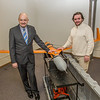"Marty Rogers, left, chief operating officer with the Alaska Center for Unmanned Aircraft Systems Integration (ACUASI), stands with Sigurder Hrafnsson, chairman of the UAS test site and research facilities in Iceland by one of their test aircraft at the ACUASI offices in Fairbanks.  <div class=""ss-paypal-button"">Filename: AAR-14-4090-20.jpg</div><div class=""ss-paypal-button-end"" style=""""></div>"