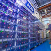 """Research technician David Light inspects the battery bank in one of the modules in the Alaska Center for Energy and Power's Technology Center.  <div class=""""ss-paypal-button"""">Filename: AAR-12-3479-060.jpg</div><div class=""""ss-paypal-button-end"""" style=""""""""></div>"""