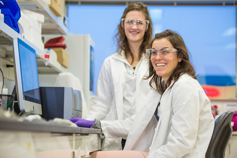 """Undergraduate Alyssa Komac, right, and graduate student Theresia Schnurr study the data they're getting in their research involving the metabolism in Alaska sled dogs.  <div class=""""ss-paypal-button"""">Filename: AAR-12-3673-126.jpg</div><div class=""""ss-paypal-button-end"""" style=""""""""></div>"""