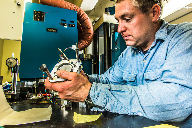 """Research professional Matt Bray prepares concrete samples for testing under extreme pressure in a Duckering Building rock mechanics lab.  <div class=""""ss-paypal-button"""">Filename: AAR-13-3919-65.jpg</div><div class=""""ss-paypal-button-end"""" style=""""""""></div>"""