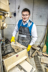 UAF graduate student Erdenebaatar Dondov works with samples of rare earth minerals in a Duckering Building lab. Narantsetseg is part of a partnership between UAF and the Mongolian government to establish a school of mining engineering there to educate locals to help develop the country's mineral resources.  Filename: AAR-13-3842-113.jpg