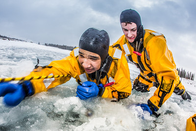 Jordan Sanchez, left, and Joshua Stern practice cold-water rescue techniques this morning with the University of Alaska Fairbanks Fire Department.  Filename: AAR-13-3797-41.jpg