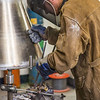 "Art major Joel Isaak positions equipment prior to pouring molten bronze as part of the process of creating a life-sized sculpture for his senior thesis in the UAF Fine Arts complex.  <div class=""ss-paypal-button"">Filename: AAR-12-3347-006.jpg</div><div class=""ss-paypal-button-end"" style=""""></div>"