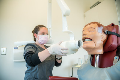 CTC dental assistant student Abigail Bazon practices digital radiography at the program's facility on Barnette Street in downtown Fairbanks.  Filename: AAR-16-4873-102.jpg