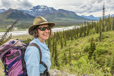 Associate professor Margaret Darrow pauses as she hikes down one of a series of frozen debris lobes which have appeared along the Dietrich River valley in the southern Brooks Range about 225 miles north of Fairbanks. Darrow and a team of state geologists are investigating ways to slow down or step the movement of the lobes, which could threaten the Dalton Highway and the nearby trans-Alaska pipeline.  Filename: AAR-14-4214-217.jpg