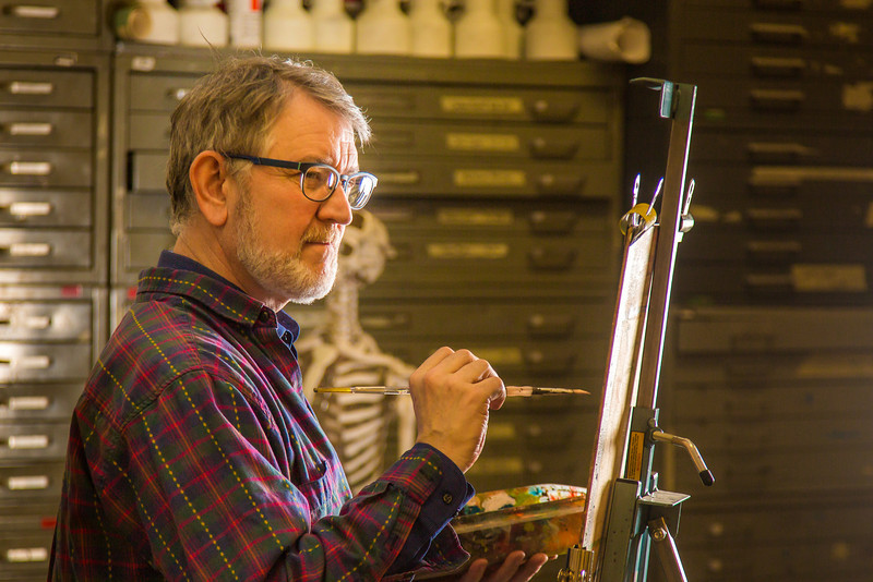"""Professor Todd Sherman, dean of UAF's College of Liberal Arts, studies a model while leading a portrait painting class during the 2014 Wintermester in the Fine Arts complex.  <div class=""""ss-paypal-button"""">Filename: AAR-14-4032-1.jpg</div><div class=""""ss-paypal-button-end"""" style=""""""""></div>"""