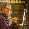 "Professor Todd Sherman, dean of UAF's College of Liberal Arts, studies a model while leading a portrait painting class during the 2014 Wintermester in the Fine Arts complex.  <div class=""ss-paypal-button"">Filename: AAR-14-4032-1.jpg</div><div class=""ss-paypal-button-end"" style=""""></div>"