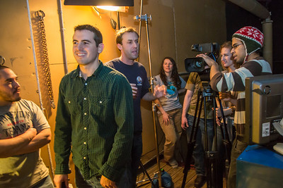 Students in visiting lecturer Dave Selle's 2013 Wintermester cinematography class listen to comments before shooting a scene in the UAF Fine Arts complex.  Filename: AAR-13-3690-6.jpg