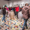 "Patrons walked somewhat gingerly on the ceramic artwork produced by Ian Wilkinson for his BFA thesis during the opening of his show in the gallery in the UAF Fine Arts Complex.  <div class=""ss-paypal-button"">Filename: AAR-13-3780-361.jpg</div><div class=""ss-paypal-button-end"" style=""""></div>"