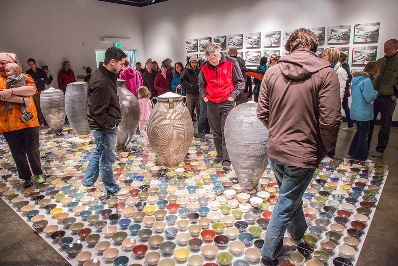 """Patrons walked somewhat gingerly on the ceramic artwork produced by Ian Wilkinson for his BFA thesis during the opening of his show in the gallery in the UAF Fine Arts Complex.  <div class=""""ss-paypal-button"""">Filename: AAR-13-3780-361.jpg</div><div class=""""ss-paypal-button-end"""" style=""""""""></div>"""