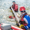 "Dick Rice with Rescue Alaska, top, demonstrates swiftwater rescue and safety techniques to staff members and graduate students from the Water and Environmental Research Center (WERC) and the Institute of Northern Engineering (INE) in the Chena River.  <div class=""ss-paypal-button"">Filename: AAR-13-3813-124.jpg</div><div class=""ss-paypal-button-end"" style=""""></div>"