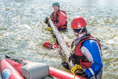 Dick Rice with Rescue Alaska, top, demonstrates swiftwater rescue and safety techniques to staff members and graduate students from the Water and Environmental Research Center (WERC) and the Institute of Northern Engineering (INE) in the Chena River.  Filename: AAR-13-3813-124.jpg