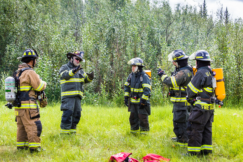 """Program coordinator and Associate Professor of Fire Science John George instructs cadets on the proper use of fire extinguishers during the 2016 Summer Fire Academy at the University Fire Department's station on University Avenue.  <div class=""""ss-paypal-button"""">Filename: AAR-16-4937-42.jpg</div><div class=""""ss-paypal-button-end""""></div>"""