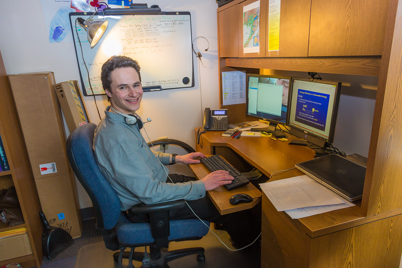 """Assistant Professor Tom Marsik works in his office at UAF's Bristol Bay Campus in Dillingham. Marsik runs the school's environmental studies program and has taken a leading role in developing alternative energy strategies and energy efficiency standards in rural Alaska.  <div class=""""ss-paypal-button"""">Filename: AAR-16-4860-296.jpg</div><div class=""""ss-paypal-button-end""""></div>"""