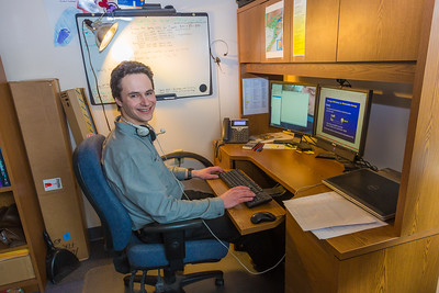 Assistant Professor Tom Marsik works in his office at UAF's Bristol Bay Campus in Dillingham. Marsik runs the school's environmental studies program and has taken a leading role in developing alternative energy strategies and energy efficiency standards in rural Alaska.  Filename: AAR-16-4860-296.jpg