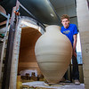"Art major Ian Wilkinson removes one of his giant ceramic vessels he made as for his senior thesis from a kiln in the UAF ceramics studio.  <div class=""ss-paypal-button"">Filename: AAR-13-3744-47.jpg</div><div class=""ss-paypal-button-end"" style=""""></div>"