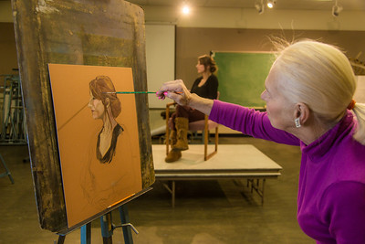 Peggy Swartz at work during the portrait painting class in the UAF Fine Arts complex, offered during Wintermester 2014.  Filename: AAR-14-4032-20.jpg