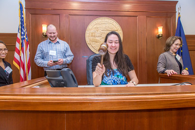 Sarah Walker, a senior in UAF's rural development program from Bethel, has some fun with the gavel moments after posing with Speaker Mike Chenault in the House chambers during a weeklong seminar on understanding the legislative process in Juneau.  Filename: AAR-14-4053-156.jpg